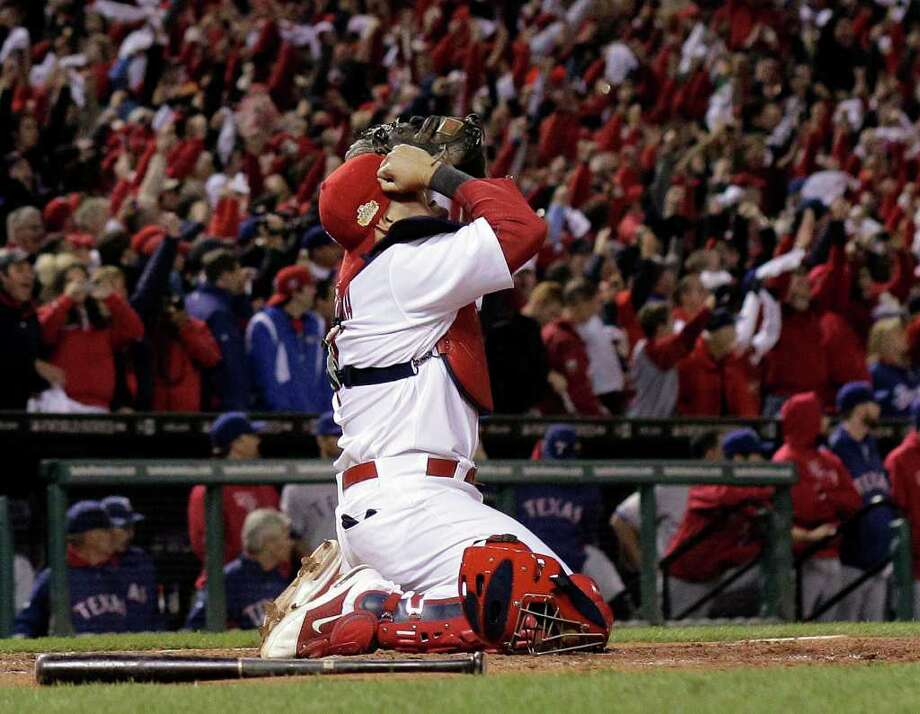 St. Louis Cardinals' Yadier Molina reacts after Texas Rangers' David Murphy flies out to end Game 7 of baseball's World Series Friday, Oct. 28, 2011, in St. Louis. The Cardinals won 6-2 to win the series. (AP Photo/Charlie Riedel) Photo: Charlie Riedel, Associated Press / Copyright 2011 The Associated Press. All rights reserved. This material may not be published, broadcast, rewritten or redistribu
