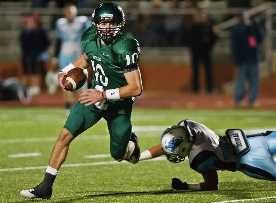 Reagan quarterback Trevor Knight looks for running room on a quarterback keeper during the third quarter of the Rattlers' game with Johnson at Heroes Stadium on Oct. 28, 2011.  MARVIN PFEIFFER/mpfeiffer@express-news.net Photo: MARVIN PFEIFFER, Express-News / Express-News 2011