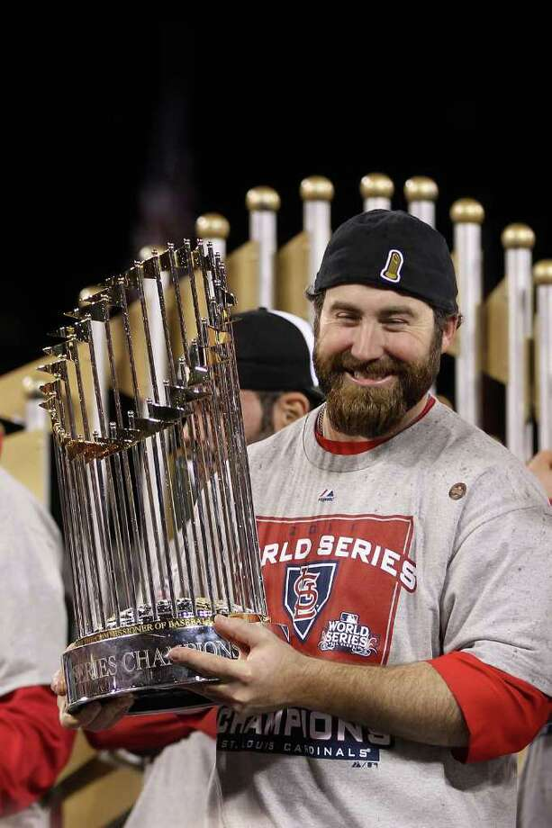 ST LOUIS, MO - OCTOBER 28:  Jason Motte #30 of the St. Louis Cardinals celebrates with the World Series trophy after defeating the Texas Rangers 6-2 in Game Seven of the MLB World Series at Busch Stadium on October 28, 2011 in St Louis, Missouri. Photo: Ezra Shaw, Getty / 2011 Getty Images