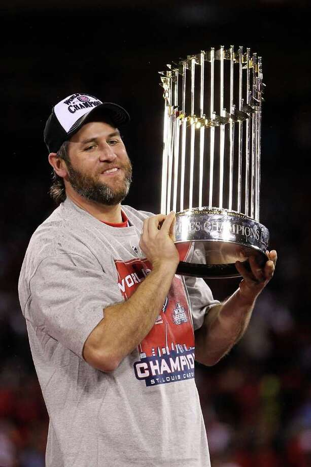 ST LOUIS, MO - OCTOBER 28:  Lance Berkman #12 of the St. Louis Cardinals holds up the World Series trophy after defeating the Texas Rangers 6-2 in Game Seven of the MLB World Series at Busch Stadium on October 28, 2011 in St Louis, Missouri. Photo: Ezra Shaw, Getty / 2011 Getty Images