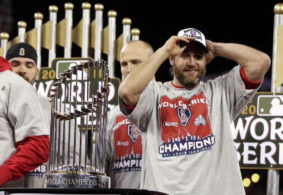 ST LOUIS, MO - OCTOBER 28:  Lance Berkman #12 of the St. Louis Cardinals celebrates with the World Series trophy after defeating the Texas Rangers 6-2 in Game Seven of the MLB World Series at Busch Stadium on October 28, 2011 in St Louis, Missouri. Photo: Ezra Shaw, Getty / 2011 Getty Images