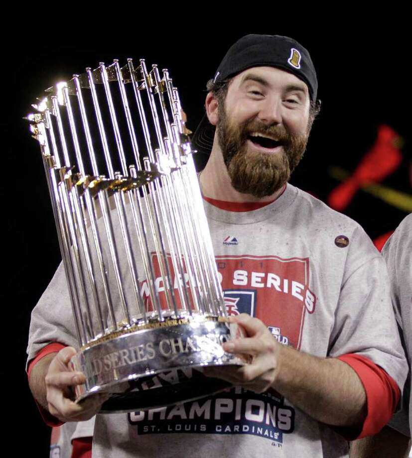 St. Louis Cardinals' Jason Motte holds up the Commissioner's Trophy after baseball's World Series against the Texas Rangers Friday, Oct. 28, 2011, in St. Louis. The Cardinals won 6-2 to win the series.  (AP Photo/Charlie Riedel) Photo: Charlie Riedel, Associated Press / AP