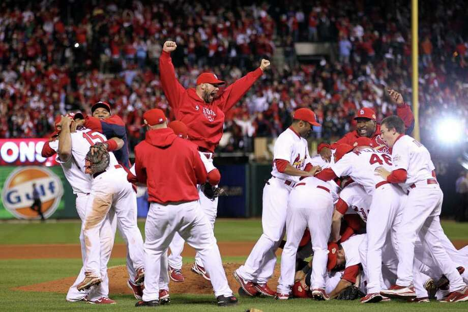 ST LOUIS, MO - OCTOBER 28:  Chris Carpenter #29 of the St. Louis Cardinals celebrates after defeating the Texas Rangers 6-2 to win Game Seven of the MLB World Series at Busch Stadium on October 28, 2011 in St Louis, Missouri. Photo: Ezra Shaw, Getty / 2011 Getty Images