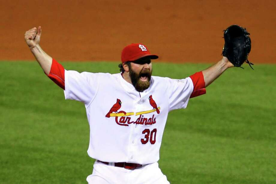 ST LOUIS, MO - OCTOBER 28:  Jason Motte #30 of the St. Louis Cardinals celebrates after defeating the Texas Rangers 6-2 to win the World Series in Game Seven of the MLB World Series at Busch Stadium on October 28, 2011 in St Louis, Missouri. Photo: Dilip Vishwanat, Getty / 2011 Getty Images