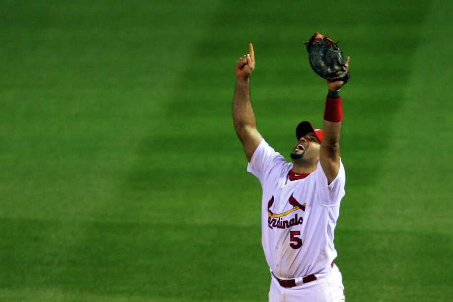 ST LOUIS, MO - OCTOBER 28:  Albert Pujols #5 of the St. Louis Cardinals celebrates after defeating the Texas Rangers 6-2 to win the World Series in Game Seven of the MLB World Series at Busch Stadium on October 28, 2011 in St Louis, Missouri. Photo: Dilip Vishwanat, Getty / 2011 Getty Images