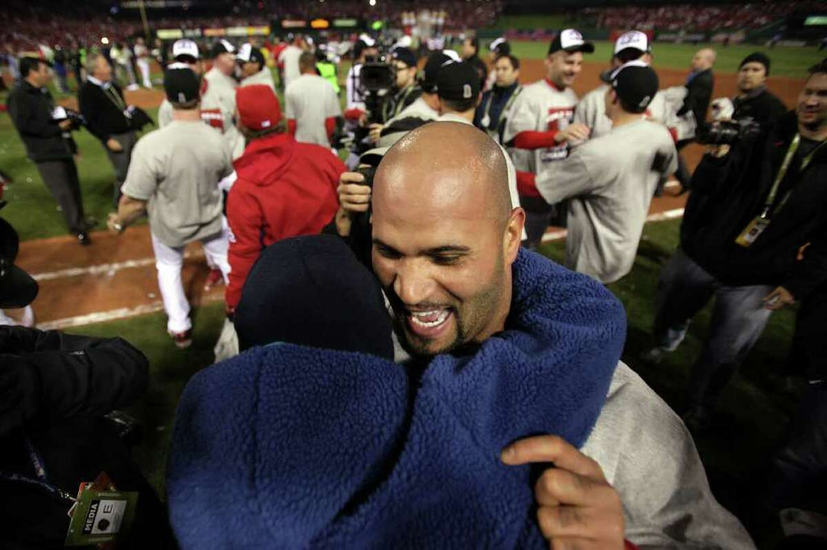ST LOUIS, MO - OCTOBER 28: Albert Pujols #5 of the St. Louis Cardinals celebrates after defeating the Texas Rangers 6-2 to win Game Seven of the MLB World Series at Busch Stadium on October 28, 2011 in St Louis, Missouri.