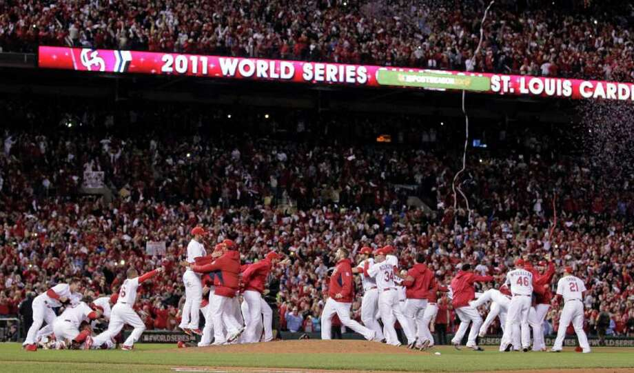 The St. Louis Cardinals celebrate after Texas Rangers' David Murphy flies out to end Game 7 of baseball's World Series Friday, Oct. 28, 2011, in St. Louis. The Cardinals won 6-2 to win the series. (AP Photo/Charlie Riedel) Photo: Charlie Riedel, Associated Press / AP