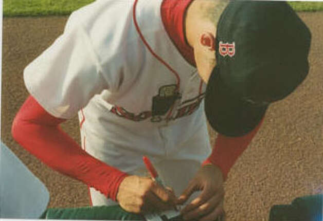 Clay Buchholz signing his very first autograph. Buchholz is from Lumberton. Photo: Courtesy Of Their Families