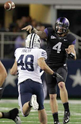 TCU quarterback Casey Pachall (4) passes against BYU linebacker Jameson Frazier (48) during the first half of an NCAA college football game at Cowboys Stadium Friday, Oct. 28, 2011, in Arlington, Texas. Photo: AP