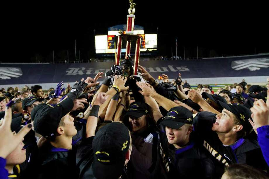 Kinkaid players celebrate with the SPC championship trophy after defeating St. Johns by a score of 28-7 at  Rice Stadium, Friday, Oct. 28, 2011, in Houston. Photo: Smiley N. Pool, Houston Chronicle / © 2011  Houston Chronicle