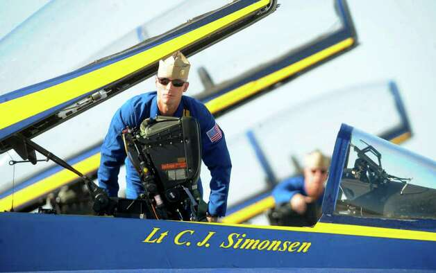 Lt. C.J. Simonsen of the Blue Angels exits his aircraft after a practice show at Randolph Air Force Base on Friday, Oct. 28, 2011. The Randolph Airshow 2011 begins on Saturday. Photo: BILLY CALZADA, Billy Calzada/gcalzada@express-news.net / gcalzada@express-news.net