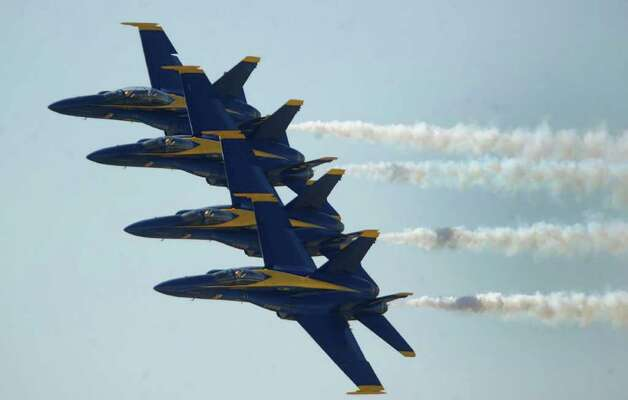 The U.S. Navy Blue Angels flight demonstration team performs a practice show at Randolph Air Force Base on Friday, Oct. 28, 2011. The Randolph Airshow 2011 begins on Saturday. Photo: BILLY CALZADA, Billy Calzada/gcalzada@express-news.net / gcalzada@express-news.net