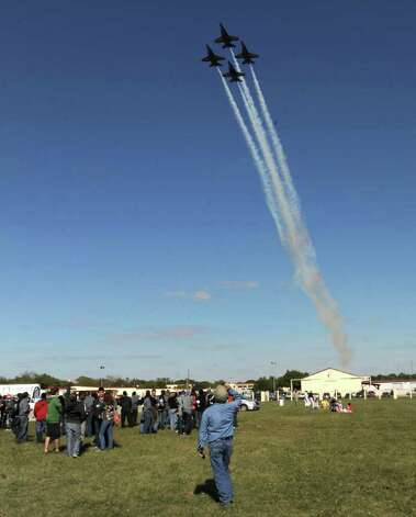 A small crowd at Randolph Air Force Base watches as the U.S. Navy Blue Angels flight demonstration team flies over on Friday, Oct. 28, 2011. Randolph Airshow 2011 begins on Saturday. Photo: BILLY CALZADA, Billy Calzada/gcalzada@express-news.net / gcalzada@express-news.net