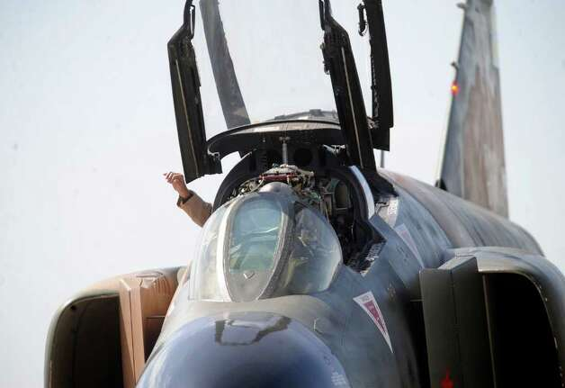 The pilot of the Collings Foundation F-4 Phantom jet fighter waves as he prepares to take off for a practice show at Randolph Air Force Base on Friday, Oct. 28, 2011. Randolph Airshow 2011 begins on Saturday. Photo: BILLY CALZADA, Billy Calzada/gcalzada@express-news.net / gcalzada@express-news.net
