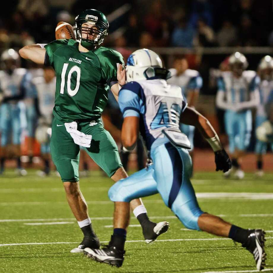 Reagan quarterback Trevor Knight tries to get a pass off as Johnson's Marcos Cardoza applies pressuer during their game at Heroes Stadium on Oct. 28, 2011.  MARVIN PFEIFFER/mpfeiffer@express-news.net Photo: MARVIN PFEIFFER, Express-News / Express-News 2011