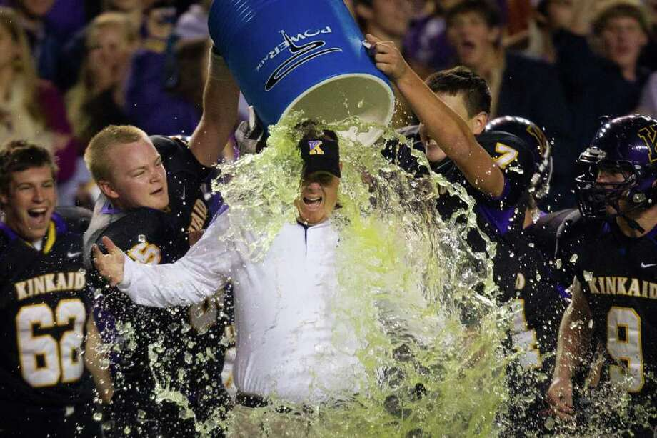 Kinkaid head coach Stephen Hill is doused by his players during the final minute of a 28-7 victory over St. John's to claim their second straight SPC championship at  Rice Stadium, Friday, Oct. 28, 2011, in Houston. Photo: Smiley N. Pool, Houston Chronicle / © 2011  Houston Chronicle