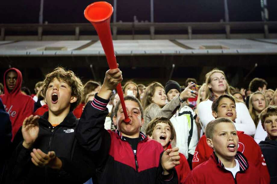 St. Johns fans cheer their team against Kinkaid during the first quarter of a high school football game at  Rice Stadium, Friday, Oct. 28, 2011, in Houston. Photo: Smiley N. Pool, Houston Chronicle / © 2011  Houston Chronicle