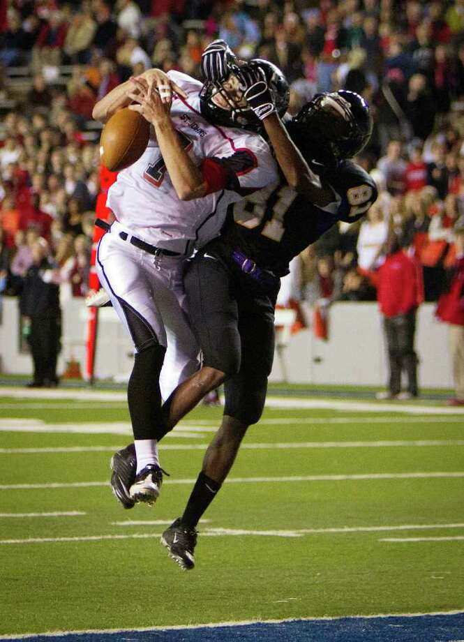 Kinkaid receiver Rodney Kennedy (81) turns defender as he keeps St. John's defensive back Grayson Crady (7) from making an interception during the second half of a high school football game at  Rice Stadium, Friday, Oct. 28, 2011, in Houston. Kinkaid won the game 28-7 to claim their second straight SPC championship. Photo: Smiley N. Pool, Houston Chronicle / © 2011  Houston Chronicle