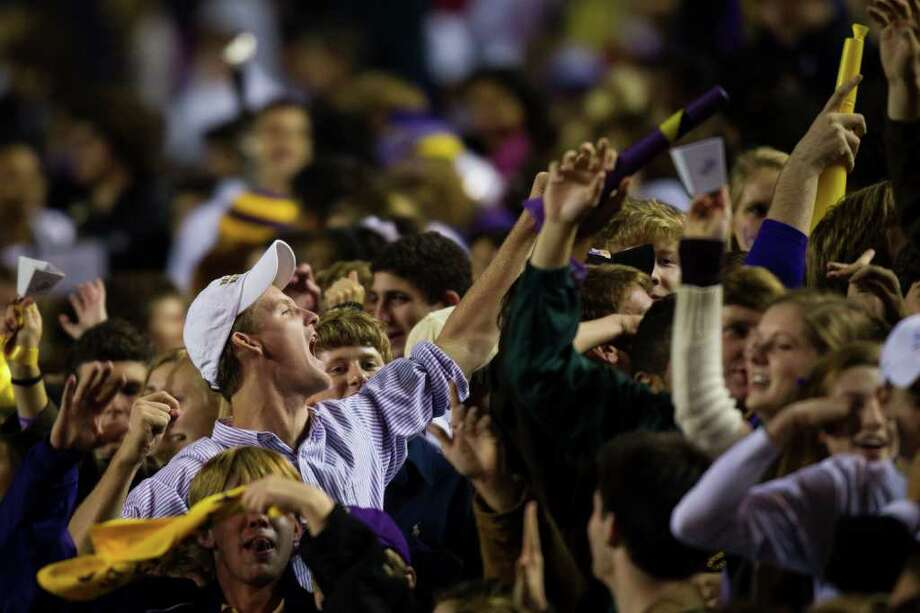 Kinkaid fans celebrate during the second half of a high school football game at  Rice Stadium, Friday, Oct. 28, 2011, in Houston. Kinkaid defeated St. John's 28-7 to claim their second straight SPC championship. Photo: Smiley N. Pool, Houston Chronicle / © 2011  Houston Chronicle