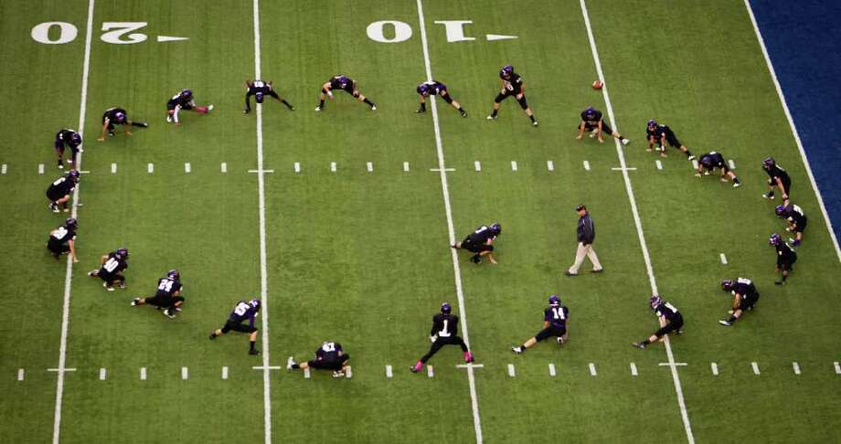 Kinkaid players warm up before a high school football game against St. Johns at  Rice Stadium, Friday, Oct. 28, 2011, in Houston. Photo: Smiley N. Pool, Houston Chronicle / © 2011  Houston Chronicle