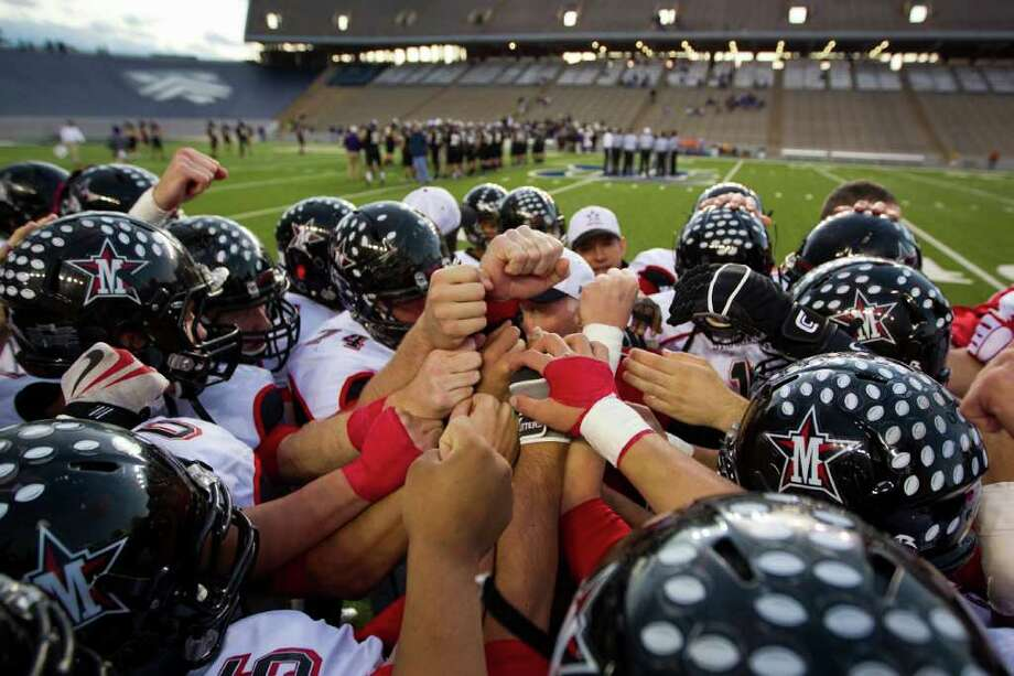 St. Johns players huddle before facing Kinkaid in a high school football game at  Rice Stadium, Friday, Oct. 28, 2011, in Houston. Photo: Smiley N. Pool, Houston Chronicle / © 2011  Houston Chronicle