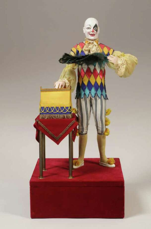 """""""The Clown Illusionist,"""" an automaton made between 1895 to 1910 by Phalibois of Paris, France, is part of the Murtogh D. Guinness Collection of Mechanical Musical Instruments & Automata at the Morris Museum in Morristown, N.J. Jere Ryder, the museum's conservator, will discuss the collection during a talk Saturday, Nov. 5, at Westport Public Library. Photo: Contributed Photo"""