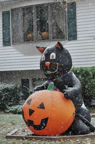 Snow is on the pumpkin outside a Danbury home Saturday, Oct. 29, 2011. Photo: Michael Duffy