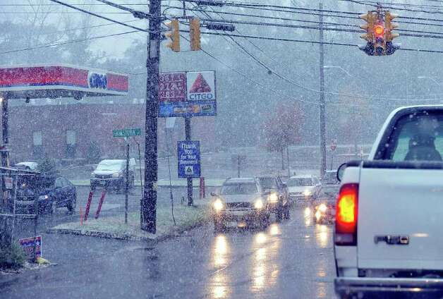 Heavy snow began falling in Danbury about noon Saturday, Oct. 29, 2011. Photo: Michael Duffy
