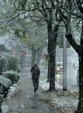 Anthony Bounadonna walks through the snow on Main Street Danbury Saturday, Oct. 29, 2011. Photo: Michael Duffy