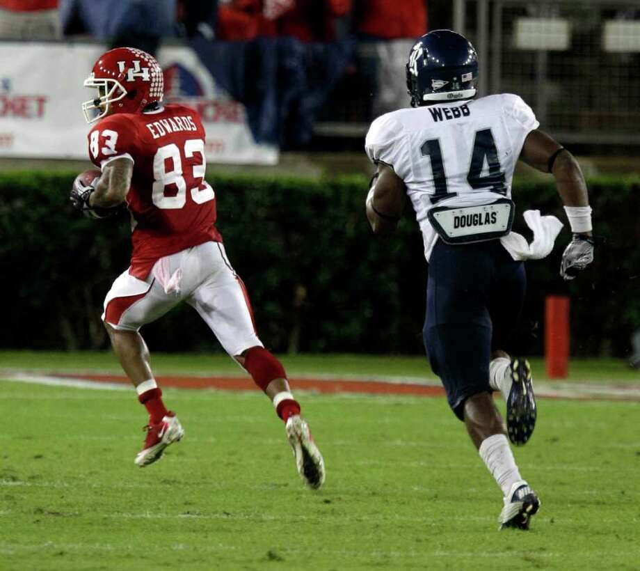 University of Houston Patrick Edwards runs for a touchdown ahead of Rice University Xavier Webb during the second quarter in game at Robertson Stadium Thursday, Oct. 27, 2011, in Houston. Photo: Melissa Phillip, Houston Chronicle / © 2011 Houston Chronicle