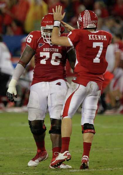 University of Houston Jacolby Ashworth, left, and QB Case Keenum celebrate touchdown by Patrick Edwa