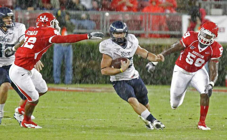 Oct. 27: No. 18 Houston 73, Rice 34 — UH defenders chase Rice's Turner Petersen during the