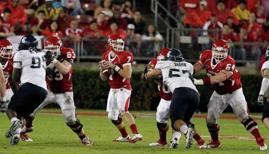 The University of Houston's quarterback Case Keenum sets up for a pass against Rice University during the third quarter of college football game action at Robertson Stadium Thursday, Oct. 27, 2011, in Houston. Photo: James Nielsen, Chronicle / © 2011 Houston Chronicle