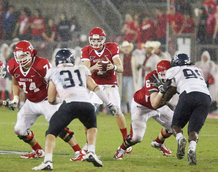 The University of Houston's quarterback Case Keenum sets up for a pass against Rice University durin