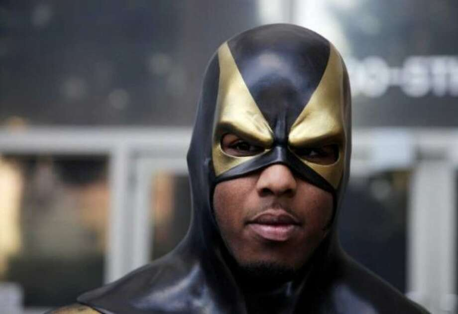 Ben Fodor gained international attention walking around the streets of Seattle as Phoenix Jones Guardian of Seattle. Photo: AP Photo