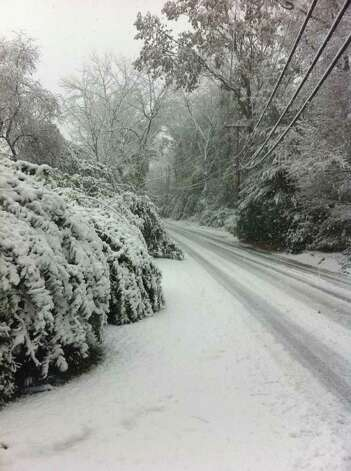Snow covers the ground on Hurlbutt Street in Wilton, Conn. on Saturday, Oct. 29, 2011 as a freak winter storm pelts Connecticut. Photo: David McCumber