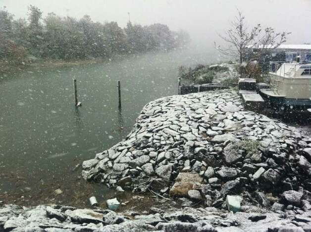 Snow covers the ground at Brewer Yacht Haven Marina in Stamford, Conn. on Saturday, Oct. 29, 2011 as a freak winter storm hits Connecticut. Photo: Ben Doody