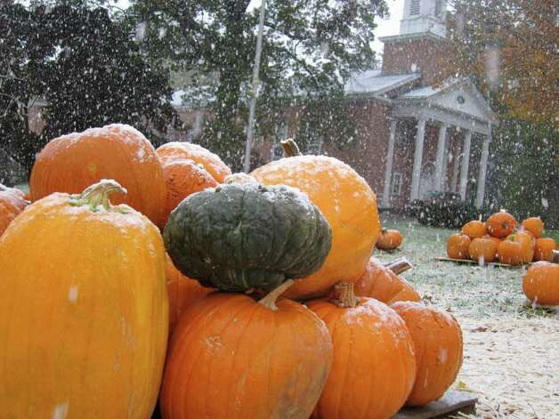 Snow falls on pumpkins for sale at St. John's Lutheran Church on Newfield Avenue in Stamford Saturday morning. Photo: Jonathan Lucas