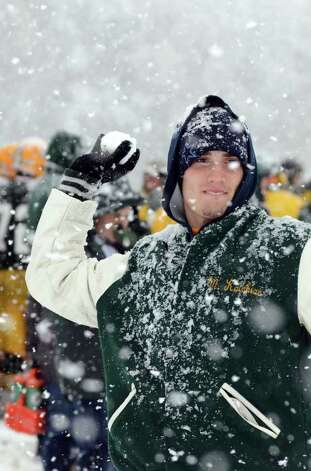 Matt Kaisian, of Stamford, throws a snow ball during the Trinity Catholic High School football game against Bassick at Trinity on Saturday, Oct. 29, 2011. Kaishian is a junior at Trinity Catholic. Photo: Amy Mortensen / Connecticut Post Freelance