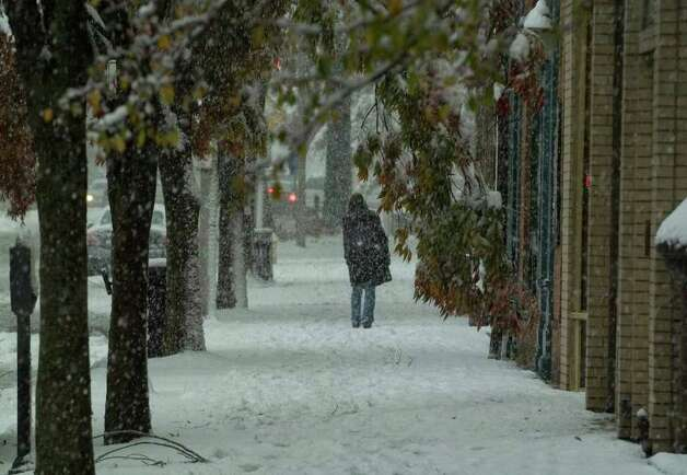 A pedestrian walks down Main Street in Danbury on Saturday, Oct. 29, 2011. Photo: Jason Rearick / The News-Times