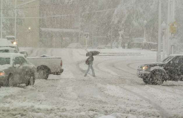 A pedestrian crosses White Street in Danbury on Saturday, Oct. 29, 2011. Photo: Jason Rearick / The News-Times