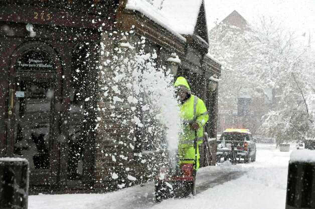 A worker blows snow near Main Street in Danbury  Saturday, Oct. 29, 2011. Photo: Michael Duffy