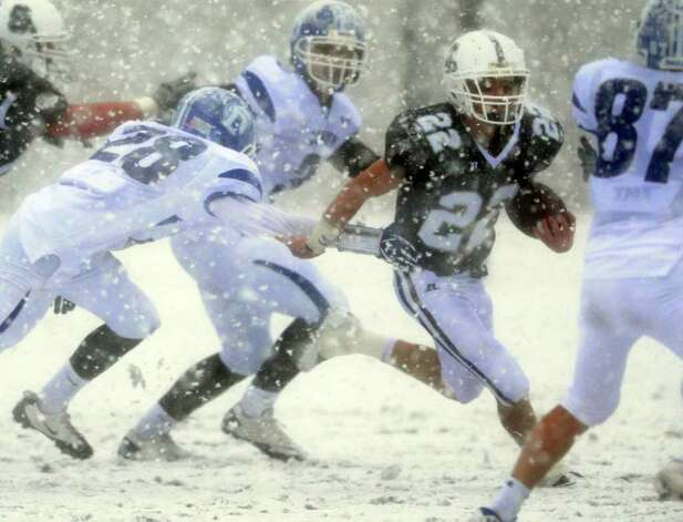 Staples' Joey Zelkowitz tries to fend off Darien's Ian Vanderhorn Saturday, Oct. 29, 2011 during their football game in Westport, Conn. Photo: Autumn Driscoll / Connecticut Post
