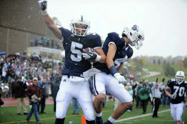Staples' Nick Kelly celebrates his touchdown with teammate James Fruscaiante Saturday, Oct. 29, 2011 during their football game against Darien at the Staples campus in Westport, Conn. Photo: Autumn Driscoll / Connecticut Post