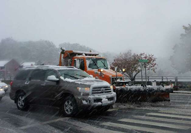 Snow plow deployed to clear Route 1 over the Saugatuck River in Westport on Saturday afternoon. Photo: Paul Schott / Westport News