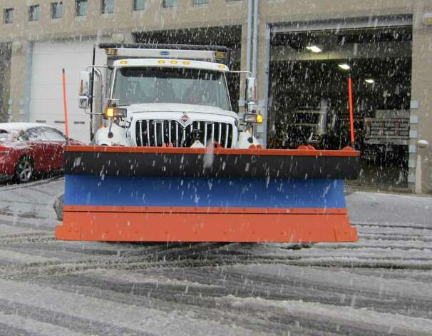 Stamford Department of Operations crews head out from the city garage on Magee Avenue early Saturday afternoon to clear snow from a pre-Halloween nor'easter. Photo: Jonathan Lucas