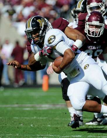 Missouri quarterback James Franklin, foreground, is sacked by Texas A&M 's Damontre Moore as Spencer Nealy (99) follows during the first half of an NCAA college football game Saturday, Oct. 29, 2011, in College Station, Texas. (AP Photo/Pat Sullivan) Photo: Associated Press