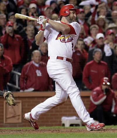 St. Louis Cardinals' Lance Berkman hits a run-scoring single during the 10th inning of Game 6 of baseball's World Series against the Texas Rangers Thursday, Oct. 27, 2011, in St. Louis. (AP Photo/Charlie Riedel) Photo: Associated Press
