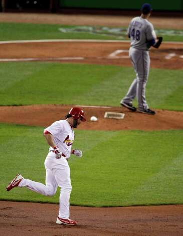 St. Louis Cardinals' Lance Berkman rounds the bases after hitting a two-run home run off Texas Rangers starting pitcher Colby Lewis during the first inning of Game 6 of baseball's World Series Thursday, Oct. 27, 2011, in St. Louis. (AP Photo/Jeff Roberson) Photo: Associated Press