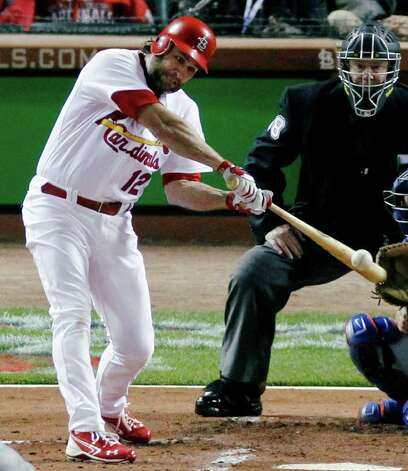 St. Louis Cardinals' Lance Berkman hits a two-run home run off Texas Rangers starting pitcher Colby Lewis during the first inning of Game 6 of baseball's World Series Thursday, Oct. 27, 2011, in St. Louis. (AP Photo/Jeff Roberson) Photo: Associated Press